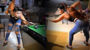 Bar girl playing pool in Jomtien Rompho complex