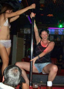Farang lady pole-dancing in a GoGo bar at Jomtien