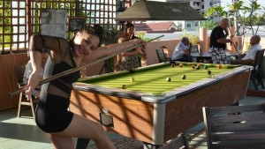 Bar girls enjoying a game of pool