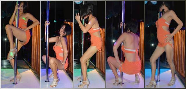 Bar girl pole-dancing in a gentlemen's club