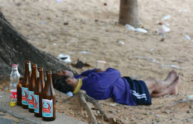 drunk-thai-man-on-beach-lao-khao