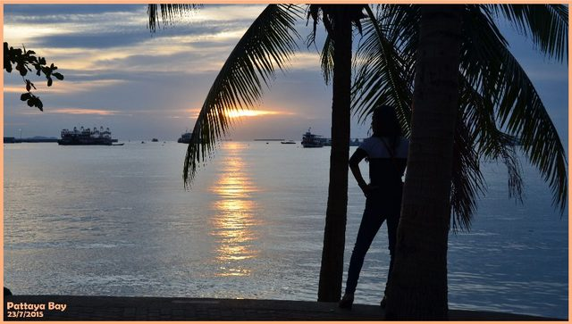 Pattaya beach sunset with ladyboy