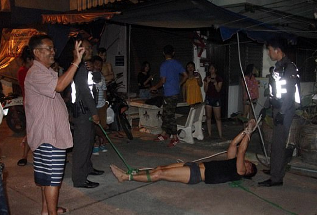 Half-Naked Farang Caught Running Across Roofs in Pattaya