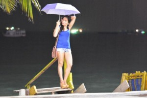 Freelancer on Pattaya beach on a rainy night