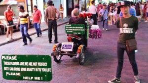 Flower vendor in wheelchair on Walking Street